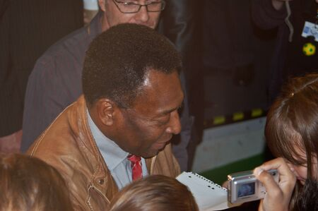 BERLIN, GERMANY - JUNE 7TH: Edson Arantes do Nascimento, Pele, signing autographs during the opening o the Pelestation Exhibition on June 7th, 2006. photo
