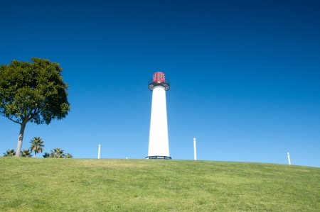 Long Beach marina lighthouse under a bright blue sky photo
