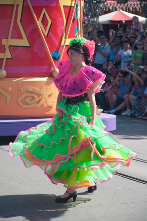 Anaheim, CA - May 27 2011  Unidentified Mexican dancers perform in traditional costumes on stage at the Disneyland parade in Anaheim, CA on JMay 27 2011