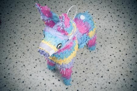 Colorful donkey pinata over blurred backgound photo