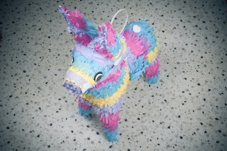 pinata: Colorful donkey pinata over blurred backgound