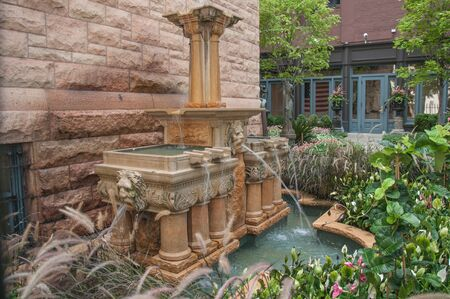 stone wall: Old style vintage water fountain in a historic home in downtown Chicago