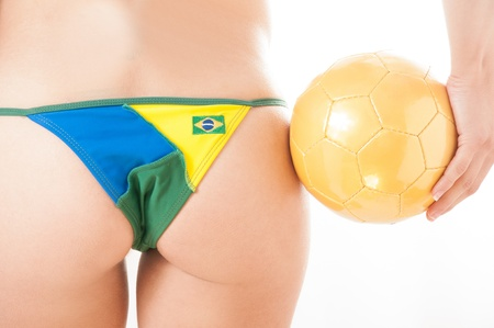 string bikini: Beautiful legs Brazilian model  wearing a flag bikini representing soccer and football team competition