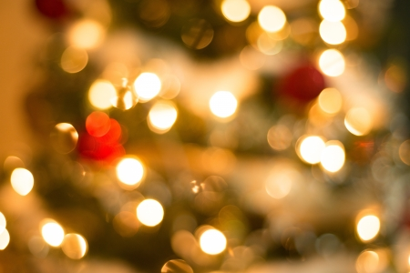blurr: Colorful ornaments and christmas decoration on green tree blurred to be used as background or texture