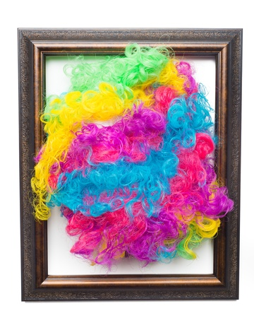Disco rainbow afro wig gramed and hanging on wall photo