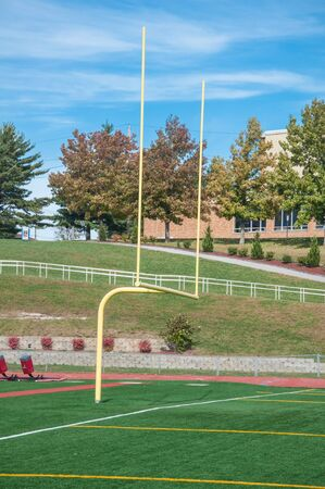 College football goal post under bright blue sky Stock Photo - 17080983