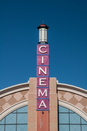 Movie theater cinema facade exterior tower under bright blue sky