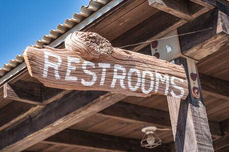 washroom: Wild old west restroom sign