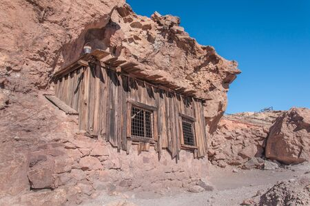 western usa: Old West Mining Shack in the California Desert under a bright blue sky