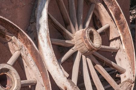 Old West Wagon Wheel otdoors under bright sunlight