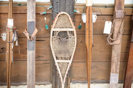 Snow Shoes and vintage skiis  on display at winter resort Stock Photo