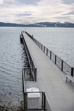 Boat Pier in Lake Tahoe on a grey winter morning photo