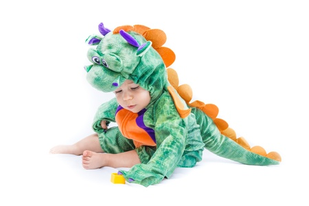 Purple, orange and green dragon costume on bay isolated on pure white photo