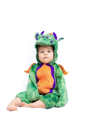 Purple, orange and green dragon costume on bay isolated on pure white