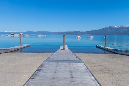 Beautiful blue clear water pier on the shore of the lake Tahoe Stock Photo