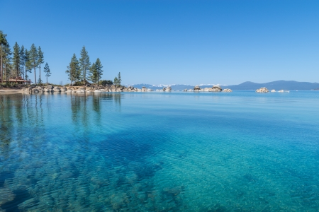 Beautiful blue clear water on the shore of the lake Tahoe