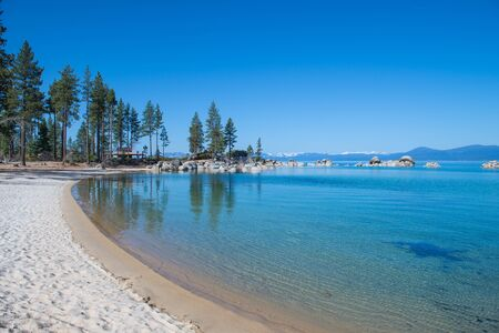 Beautiful blue clear water on the shore of the lake Tahoe photo