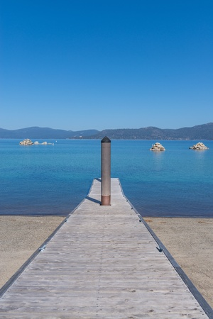 Beautiful blue clear water pier on the shore of the lake Tahoe photo