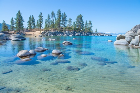 sierra nevada mountains: Beautiful blue clear water on the shore of the lake Tahoe