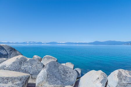 Beautiful blue clear water on the shore of the lake Tahoe Stock Photo - 19407920