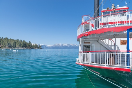 Historic touristic steamboat docked on the shores of Lake Tahoe under a bright blue sky photo