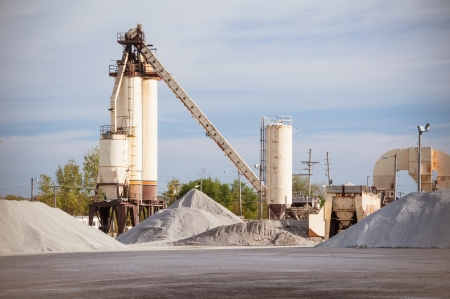 Mining industry silo in city suburb representing labor and jobs photo