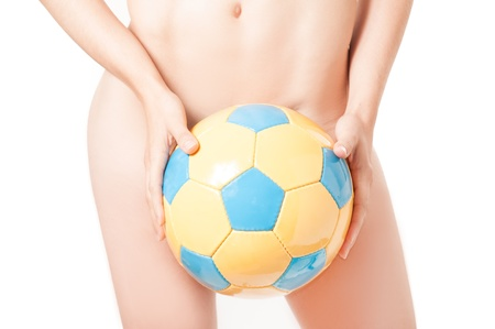 Beautiful legs Brazilian model  nude holding a ball photo