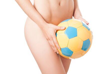 Beautiful legs Brazilian model nude holding a ball photo