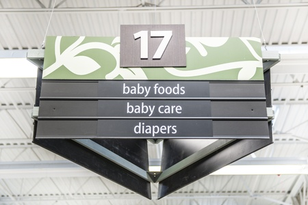 Baby food, care and diapers aisle in the supermarket