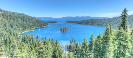 Lake Tahoe Emerald bay Island on a beautiful sunrise on the mountains representing summer vacations photo