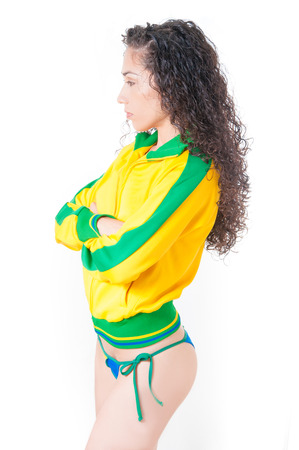 Beautiful legs Brazilian model  wearing a flag bikini representing soccer and football team competition photo