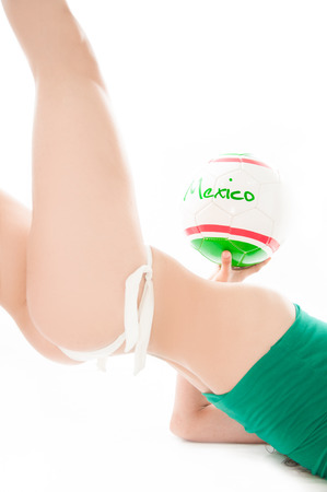 Beautiful model wearing green, red and white underwear holding a Mexico team ball isolated on white representing a soccer cheerleader