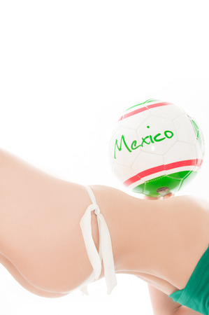 Beautiful model wearing green, red and white underwear holding a Mexico team ball isolated on white representing a soccer cheerleader photo