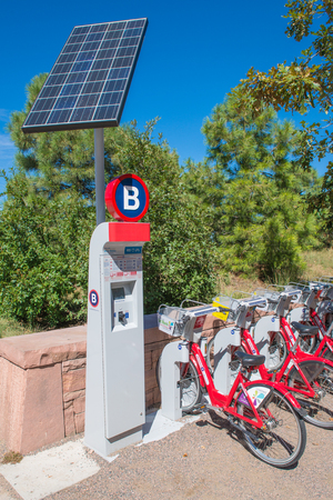 shared sharing: DENVER- SEPTEMBER 28  Citi Bike docking station on September 28, 2013 in Denver  Bike Sharing is a non-profit  that operates  to promote health, quality of life and preservation of the environment