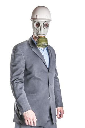 Men wearing a blue business suit and gas mask simbolizing danger in the environment photo