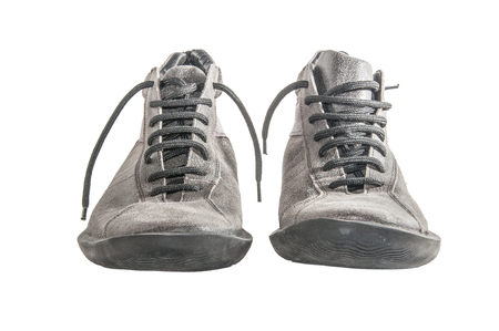 Grey lace shoes isolated over white facing front photo