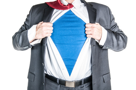 Business man tearing shirt to become a superhero Stock Photo
