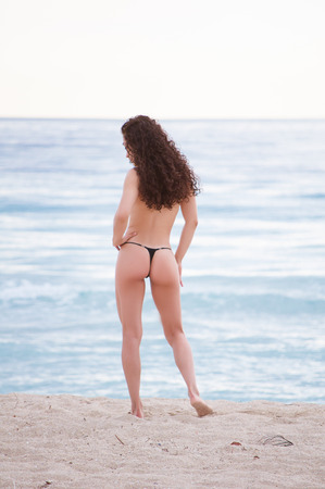 thong: Beautiful fit model wearing a thong bikini at the gorgeous blue water beaches of florida on vacation Stock Photo