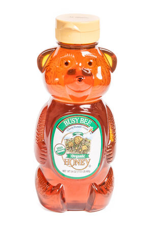 Reno, USA, : December, 2nd 2011: Bear shaped bottle of Busy Bee brand organic honey. Editöryel