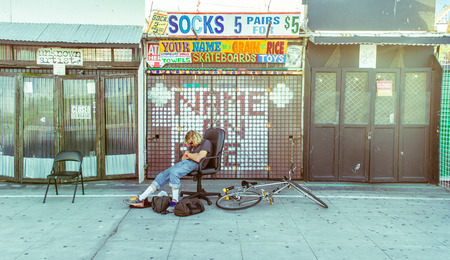LOS ANGELES, CA - OCTOBER 11th,  2015: Store vendors at the famous Venice Beach boardwalk before opening time.