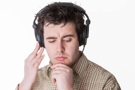 man thinks about the next music track which would fit best to his lifestyle photo