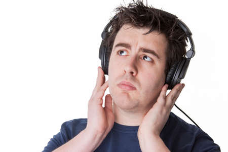 man pays his attention to the music on his headphones photo
