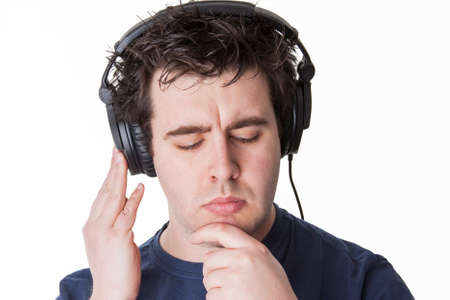 man thinks about the next music track which would fit best to his lifestyle