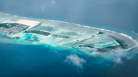 Maldives from the Sky with the blue sea and white sand and beach in the indian ocean