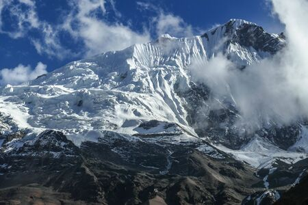 Facing a glacier in the Himalayas while hiking along the Annapurna circuit