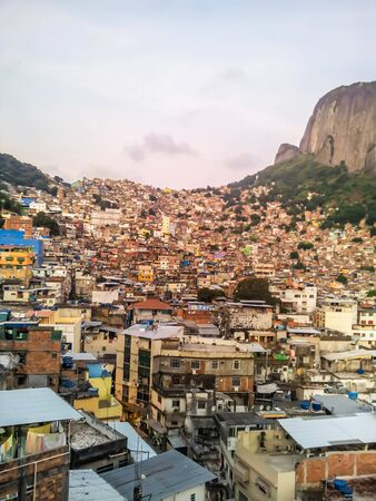 Rocinha, one of the biggest favelas in Latin America. This small city on the hill is in the heart of Rio de Janeiro in Brazil. Stock Photo