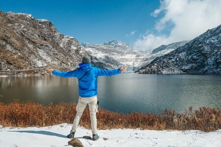 A boy enjoying the view to Tsomgo Lake in North Sikkim. Just above the mountains is Tibet.