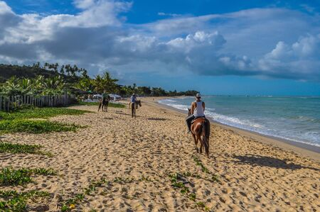 In Bahia in Brazil there are one of the most isolated beaches in the world. It is perfect for horseback riding. Once in a while you find a group of hippies enjoying their freedom.
