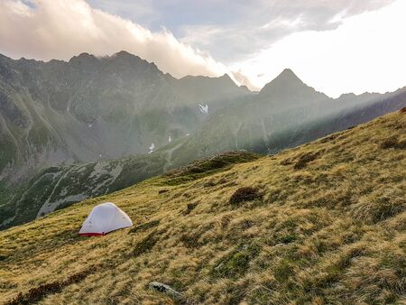 Sleeping in the wilderness in a tent in the alps of Austria is full of purity and adrenaline. The hiking tours are not frequented and you can look for inner peace. Фото со стока