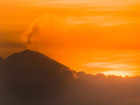 Sitting on Sengigi beach in Lombok you can see all the way to Bali where the majestic active vulcano Mount Agung is appearing in its beauty. That day he started to smoke during the sunset.